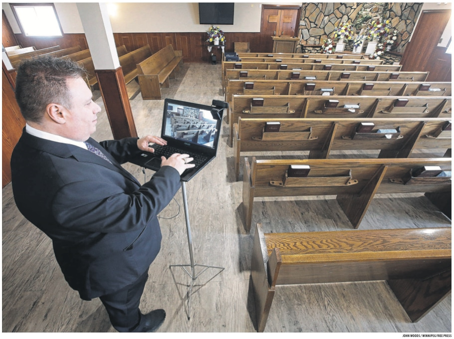 Mike Vogiatzakis, general manager of Voyage Funeral Home, sets up a computer for livestreaming Wednesday. Funeral homes are changing their practices in this time of social isolation.